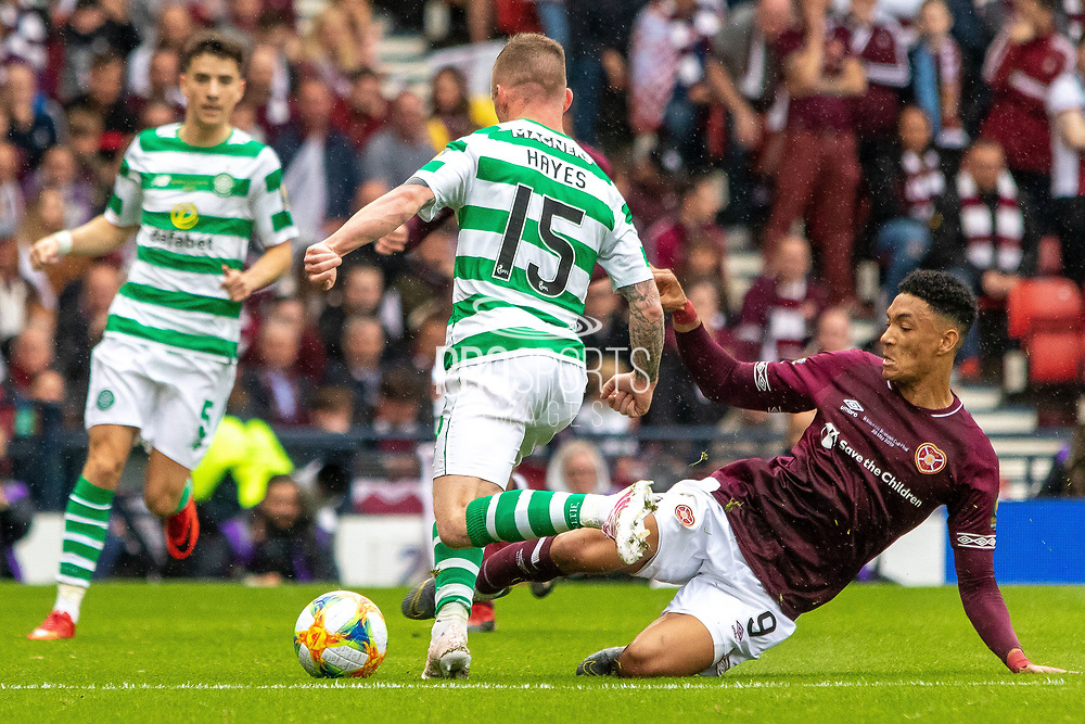 A sliding tackle from Sean Clare of Hearts on Jonny Hayes of Celtic during the William Hill Scottish Cup Final match between Heart of Midlothian and Celtic at Hampden Park, Glasgow, United Kingdom on 25 May 2019.