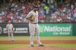 May 23, 2018 - Arlington, TX, U.S. - ARLINGTON, TX - MAY 23: New York Yankees starting pitcher CC Sabathia (52) looks to the catcher for a sign during the game between the New York Yankees and the Texas Rangers on May 23, 2018 at Globe Life Park in Arlington, TX. (Photo by George Walker/Icon Sportswire) (Credit Image: © George Walker/Icon SMI via ZUMA Press)