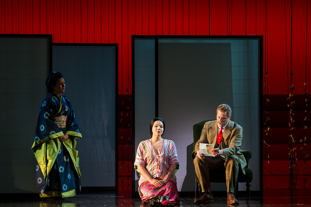 """LONDON, UK, 14 May, 2016. Stephanie Windsor-Lewis (left, as Suzuki), Rina Harms (centre, as Butterfly) and George von Bergen (as Sharpless) rehearse for the revival of director Anthony Minghella's production of Puccini's opera """"Madam Butterfly"""" at the London Coliseum for the English National Opera. The production opens on 16 May. Photo credit: Scott Rylander."""