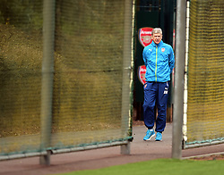 Arsenal's Manager Arsene Wenger makes his way to training during a training session at London Colney, Hertfordshire.