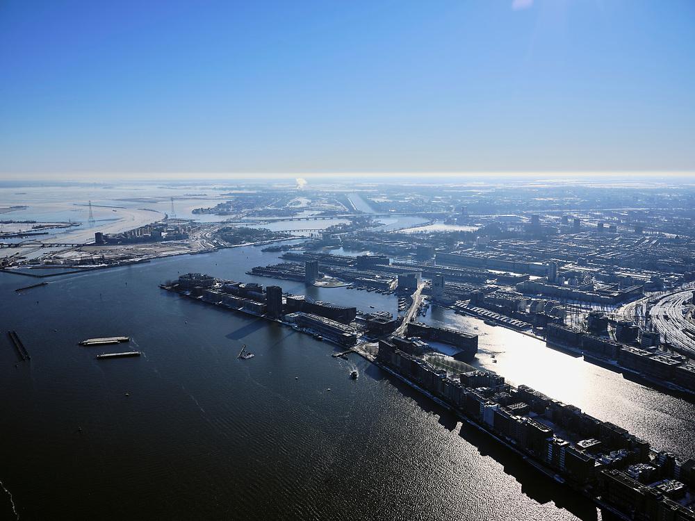 Nederland, Noord-Holland, Amsterdam, 13-02-2021; Voormalig Oostelijk havengebied met Java-eiland en KNSM-eiland.<br /> Gezien naar Zeeburgereiland en IJburg.<br />  <br /> luchtfoto (toeslag op standaard tarieven);<br /> aerial photo (additional fee required)<br /> copyright © 2021 foto/photo Siebe Swart