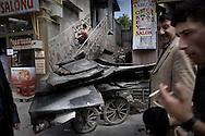Worker renovating a shop at the Kars center.