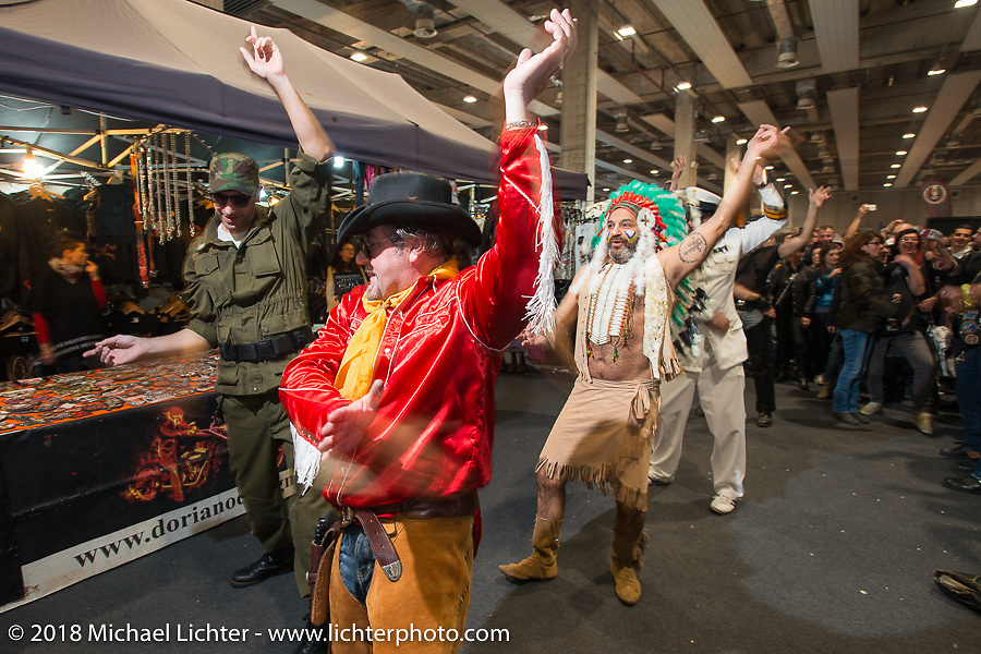 """""""Village People"""" dress-ups having a blast singing and dancing with the crowds during Motor Bike Expo. Verona, Italy. January 23, 2016.  Photography ©2016 Michael Lichter."""