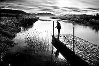 A man fishes on Utah Lake, Utah, December 2007.