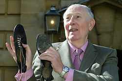 File photo dated 06-05-2004 of Sir Roger Bannister with his old running shoes on the 50th anniversary of the first sub-four-minute mile at Pembroke College, Oxford. Sir Roger was a 25-year-old medical student when he recorded a time of 3 minutes 59.4 seconds for the mile on May 6 1954.