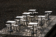 Empty tables and chairs out of season on Brighton beach on the South Coast, England<br /> FINE ART PHOTOGRAPHY by Tim Graham