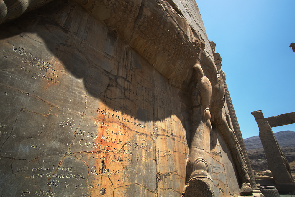 """First thing you see when entering the ruins of Persepolis, the ceremonial capital of the Achaemenid Empire, is the Gate of All Nations. The Palace is """"decorated"""" with carvings from the late 1890s. Looks like the tradition of writing """"Joe was here"""" dates back centuries."""
