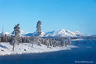 The Madison River with Mt Holmes and Gallatin Range in background at Yellowstone National Park in winter