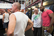 UFC light heavyweight Jon Jones chats with coach Mike Winkeljohn's father at Jackson Wink MMA in Albuquerque, New Mexico on June 9, 2016.