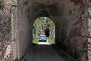 Car going through a tunnel in Gibara, Holguin, Cuba.