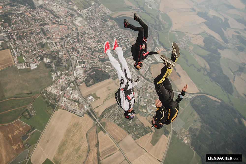 Marco Fürst is leading a formation with Sigi Schenk and Steffi Liller directly over the city of Klatovy