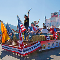 A Tea Party conservatives brandishes his rifle during the Fourth of July parade in Butte, Montana.