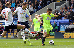 Tom Nichols of Peterborough United is tracked by Dorian Dervite of Bolton Wanderers - Mandatory by-line: Joe Dent/JMP - 30/04/2017 - FOOTBALL - Macron Stadium - Bolton, England - Bolton Wanderers v Peterborough United - Sky Bet League One