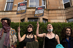 Glasgow, Scotland, UK. 13 May 2021.At approx 5.30 pm police released two men from a Home Office detention vehicle. Accompanied by lawyer Aamer Anwar the men walked to a nearby mosque surrounded by hundreds of police. Iain Masterton/Alamy Live News