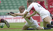 24/05/2002<br /> Sport - Rugby Union<br /> IRB World Sevens Series - Twickenham<br /> England vs Canada - Pool B<br /> Nick Duncombe and Tom May stretch for and touch down the loose ball. <br />    [Mandatory Credit, Peter Spurier/ Intersport Images]<br />    [Mandatory Credit, Peter Spurier/ Intersport Images]