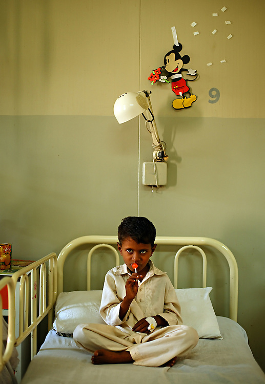 Khizer Hayat, 8, is treated for hemophilia inside the Children's Hospital at the Pakistan Institute of Medical Sciences, P.I.M.S., in Islamabad, Pakistan on Sept. 19, 2007.