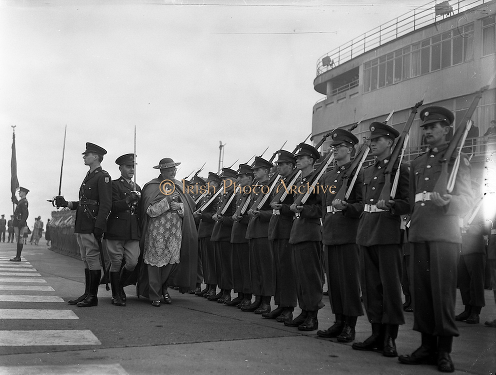 13/03/1961<br /> 03/13/1961<br /> 13 March 1961<br /> Papal Legate Cardinal James Francis McIntyre from Los Angeles arrives at Dublin Airport for the Patrician year celebrations that were held to commemorate 1,500 years of devotion to St Patrick in Ireland. Here he is pictured reviewing the Irish Army guard of honour.