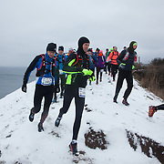 The marathon runners are off into the hills abouve Hammer Harbour. Salomon Hammer Trail Winter Edition is a first on Bornholm and is one of the toughest routes in Denmark. The 4 runs consist of a 50 mile run, a marathon, a 1/2 marathon and 10k all run a on an approximate 25km route which includes 860 meter vertical rise on the North East coast of the Danish island Bornholm. The cut-off time for the 50mile run was 16 hours and more than a hundred runners made it to the finishing line. The last runner across the line after 50 miles  was in after 15:14:40