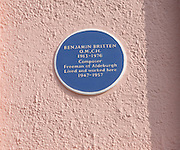 Benjamin Britten blue memorial plaque, Aldeburgh, Suffolk, England. Composer Benjamin Britten, who lived here from 1947 to 1957, left Aldeburgh a formidable musical legacy that resulted the building of the concert hall at nearby Snape Maltings.