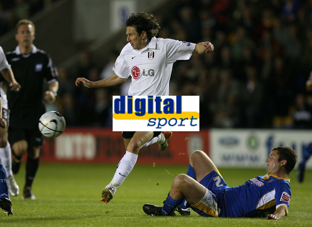 Photo: Rich Eaton.<br /> <br /> Shrewsbury Town v Fulham. Carling Cup. 28/08/2007. Fulham's Alexey Smertin leaps over Darren Moss.