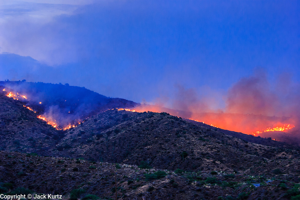 22 JUNE 2005 - CAVE CREEK, AZ:   The fireline on the Cave Creek Complex, a large wild fire which burned northeast of Phoenix. The Cave Creek Complex fire was the third largest wildfire in the state of Arizona to date, after the Rodeo-Chediski fire and Wallow Fire. The fire started on June 21, 2005 by a lightning strike during a monsoon storm and burned 243,950 acres (987.2 km2).   PHOTO BY JACK KURTZ