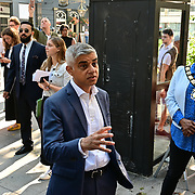 The Mayor of London, Sadiq Khan attended Let's Do London Autumn culture season with spectacular public street art installations. Joined by artist Yinka Ilori, and photographer Rankin to unveil Bring London Together – a spectacular new public art commission transforming 18 pedestrian crossings with distinctive playful designs using a bright colour pallet and bold forms. The 'Bring London Together'  at Tottenham Court Road on 2021-09-16 London, UK.