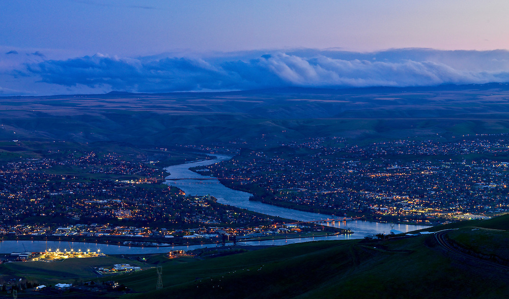 Licensing and Open Edition Prints. Overview night photo of Lewiston, Idaho (left) and Clarkston, Washington (right) with the Clearwater River joining the larger Snake River just before they enter Washington State's Palouse Agricultural Breadbasket on the way to the Columbia River and ultimately the Pacific Ocean