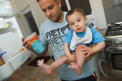 Father and son at home with yogurt.