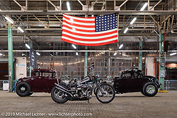 Dave Turner's custom1976 Shovelhead (in a '47 frame) and a 1932 Ford (left) and 1930 Ford Hotrods on setup day for the Congregation Show in Charlotte, NC. USA. Friday April 13, 2018. Photography ©2018 Michael Lichter.