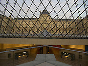 from within I. M. Pei glass pyramid looking out towards the classic Louvre building