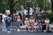 With many people and families staying in the UK for their Summer break during the school holidays, a large number of domestic tourists, who may normally have been travelling abroad, have decended on the capital to see the sights, as seen here in Leicester Square beside the Mary Poppins statue on 10th August 2021 in London, United Kingdom. Following the Coronavirus / Covid-19 health scare of the last two years, and with some travel restrictions still in place, more people have chosen a staycation which is a holiday spent in ones home country rather than abroad, or one spent at home and involving day trips to local attractions.