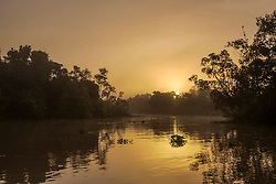 Scenic view of sunrise over river, Orinoco River, Orinoco Delta, Venezuela