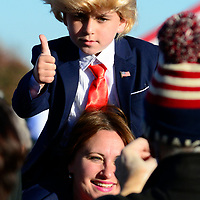 A young supporter dressed as President Trump poses for a cell phone photo before the arrival of President Donald Trump for a rally at the John Murtha Johnstown-Cambria County Airport, near Johnstown, Pennsylvania on Tuesday, October 13, 2020.  Photo by Archie Carpenter/UPI