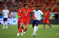 Belgium's Marouane Fellaini (left) and England's Danny Rose (right) battle for the ball during the FIFA World Cup Group G match at Kaliningrad Stadium. PRESS ASSOCIATION Photo. Picture date: Thursday June 28, 2018. See PA story WORLDCUP England. Photo credit should read: Adam Davy/PA Wire. RESTRICTIONS: Editorial use only. No commercial use. No use with any unofficial 3rd party logos. No manipulation of images. No video emulation