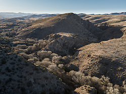 Winter aerial view of Gallina Spring area of South Fork of Palomas Creek, Ladder Ranch, west of Truth or Consequences, New Mexico, USA.