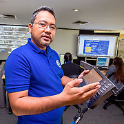 CAPTION: This is where the Operations and Warning Division receives real-time updates on rainfall, wind speed and other weather indicators. If an extreme weather event is expected, such as flooding or a typhoon, the team working here is equipped to respond immediately and coordinate with different departments. Mark Bocalbos of the Surveillance and Control Department, pictured here, feels that the early warning and emergency response system in Makati City is very effective, and he emphasises that incorporating future climate change projections into planning has already started. With the creation of a Climate Change Resilience Network that spans Metro Manila, ACCCRN hopes to provide Makati City with a channel for sharing its knowledge on early warning and response with other cities across the metropolitan area. LOCATION: Disaster Risk Reduction and Management Office, Makati, Philippines. INDIVIDUAL(S) PHOTOGRAPHED: Mark William Bocalbos.