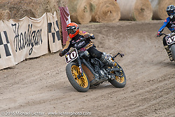 Number 10 Rolands Sands racing in the Hooligan Flat Track Race in front of the main stage at the Buffalo Chip during the annual Sturgis Black Hills Motorcycle Rally. SD, USA. August 10, 2016. Photography ©2016 Michael Lichter.