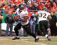 Jacksonville Jaguars quarterback David Garrard (9) rolls out during first half action against Kansas City at Arrowhead Stadium in Kansas City, Missouri, December 31, 2006.  The Chiefs beat the Jaguars 35-30.<br />