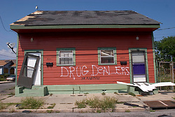 30 Sept, 2005.  New Orleans, Louisiana. Hurricane Katrina aftermath. <br /> Locals in the 9th ward add to the rescue worker graffiti by stating what they have wanted to state for years on a local house.<br /> Photo; ©Charlie Varley/varleypix.com