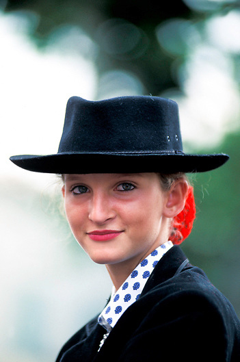 Portrait of young Provencal horsewoman in local costume in Provence, France
