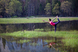 May 4, 2017 - Woman practicing yoga tree pose by lake in Yosemite National Park, California, USA (Credit Image: © Brian Holstein/Image Source via ZUMA Press)