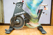 A woman peddles fast on an exercise bike during a spin class in London, England, United Kingdom.