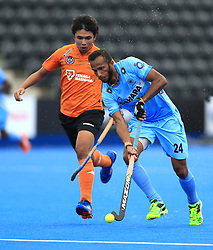 India's Sunil Sowmarpet (right) and Malaysia's Azri Hassan battle for the ball during the Men's World Hockey League match at Lee Valley Hockey Centre, London.