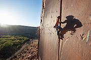 "Brad Parker climbing ""Super Crack"" at Indian Creek, near Moab, Utah"