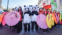 © Licensed to London News Pictures. 18/02/2018. LONDON, UK.  Performers prepare to take part in Chinese New Year celebrations in Chinatown to welcome the Year of the Dog in a parade featuring dragon and lion dancers and traditional costumed characters.  Chinese New Year in the capital draws hundreds of thousands of Londoners and tourists to enjoy the festivities and is the biggest such celebration outside Asia.  Photo credit: Stephen Chung/LNP