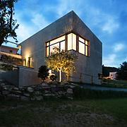 external of a modern house, night scene