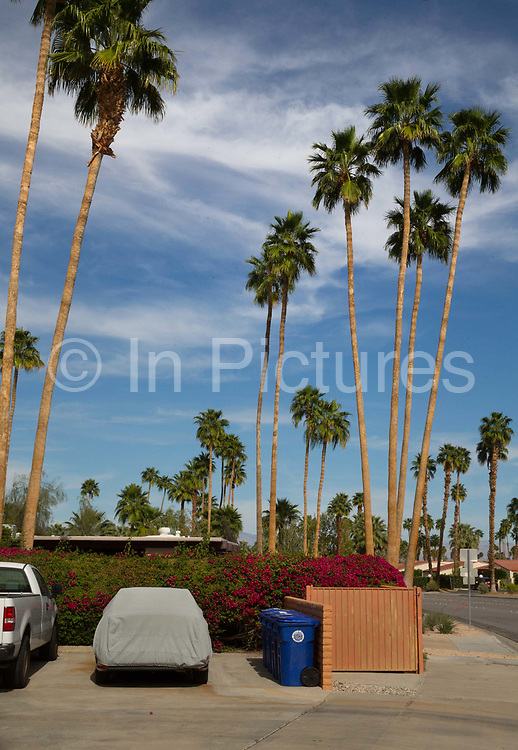 Car covered in a tarpauline to protect the paintwork from the desrt sun, Palm Springs, California