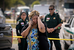 April 27, 2017 - Florida, U.S. - A woman sobs and talks on phone near the scene of a shooting that took place on Bowman St. in Greenacres that left 2 people dead Thursday afternoon. (Credit Image: © Damon Higgins/The Palm Beach Post via ZUMA Wire)