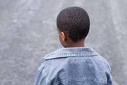 Back view of young boy alone,