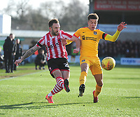 Lincoln City's Neal Eardley battles with Northampton Town's Shaun McWilliams<br /> <br /> Photographer Andrew Vaughan/CameraSport<br /> <br /> The EFL Sky Bet League Two - Lincoln City v Northampton Town - Saturday 9th February 2019 - Sincil Bank - Lincoln<br /> <br /> World Copyright © 2019 CameraSport. All rights reserved. 43 Linden Ave. Countesthorpe. Leicester. England. LE8 5PG - Tel: +44 (0) 116 277 4147 - admin@camerasport.com - www.camerasport.com